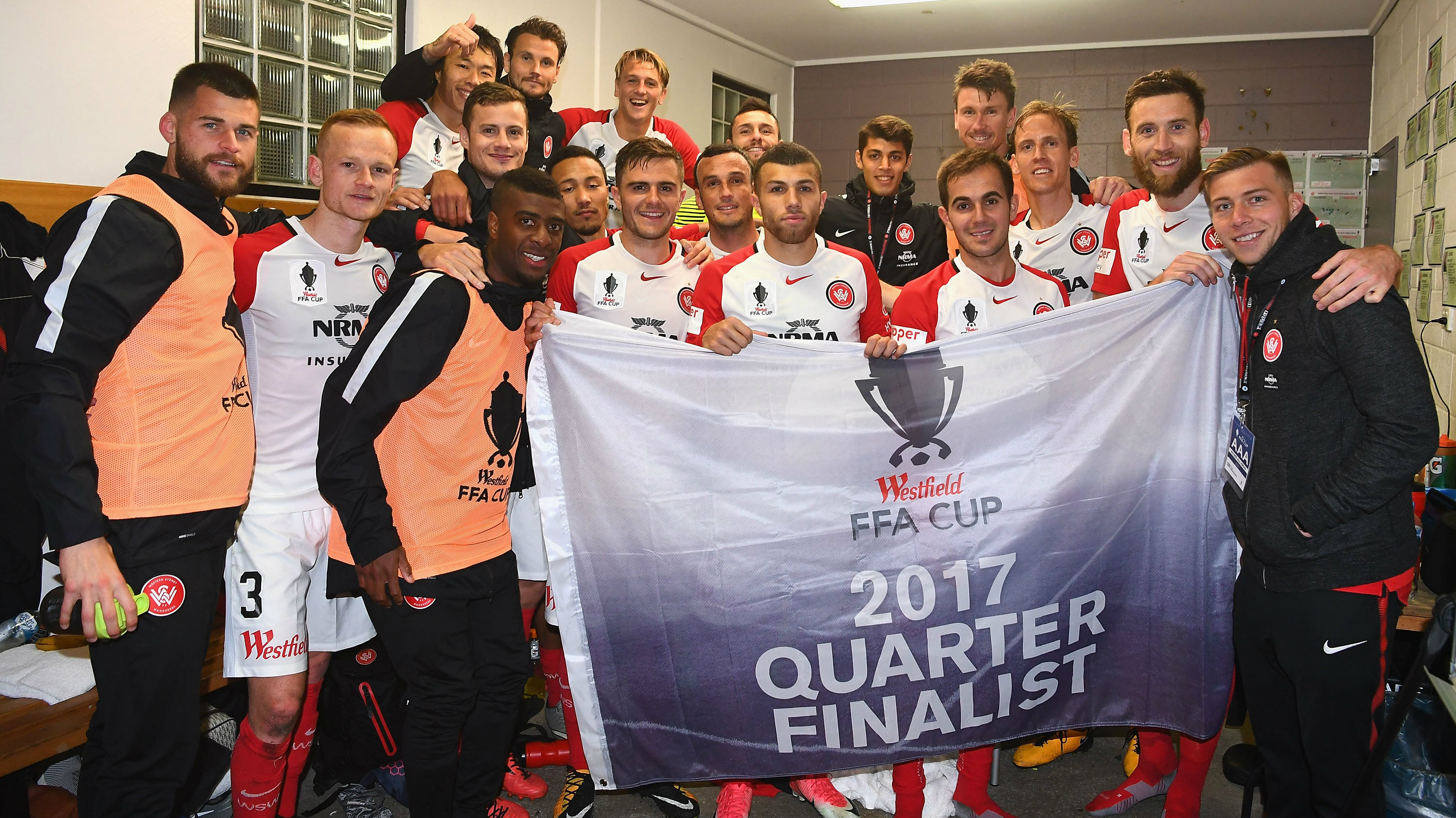 Wanderers players celebrate progressing to the FFA Cup Quarter Finals.