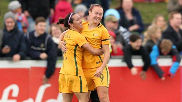 Matildas co-captain Lisa De Vanna celebrates a goal with Caitlin Foord.
