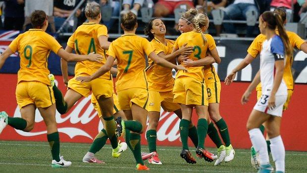 The Matildas celebrate Tameka Butt's goal in their win over the USA.