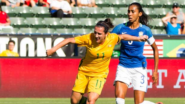 Lisa De Vanna holds off a Brazilian defender during the Westfield Matildas 6-1 win at the Tournament of Nations.