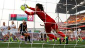 USA goalkeeper Hope Solo makes a save against the Matildas.