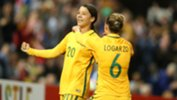 Sam Kerr and Chloe Logarzo celebrate a goal in the win over Brazil in Newcastle.