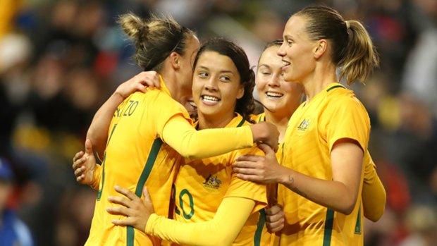 Westfield Matildas players celebrate one of Sam Kerr's goals against Brazil in Newcastle.