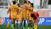 The Westfield Matildas players show their excitement after drawing level in the second half.