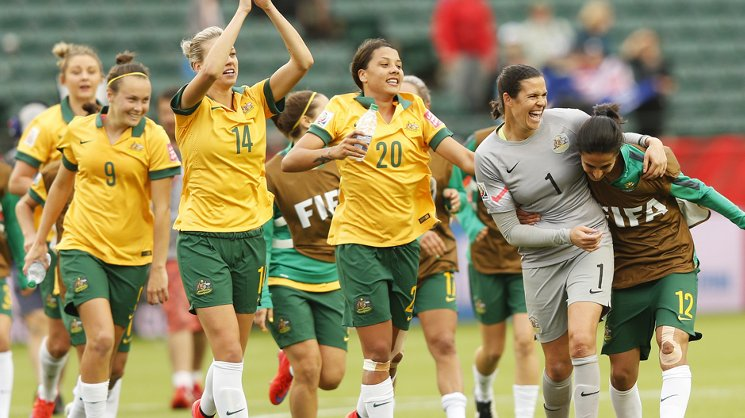 Matildas players acknowledge the crowd after their 1-1 draw with Sweden.