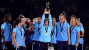 Lisa De Vanna holds the Tournament of Nations trophy aloft.