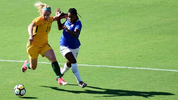 Ellie Carpenter battles for possession with a Brazilian attacker during the Tournament of Nations.