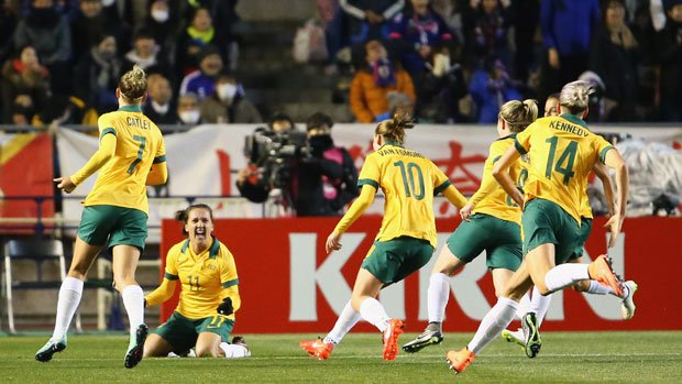 Westfield Matildas players celebrate Lisa De Vanna's opening goal against Japan in Olympic qualifying.