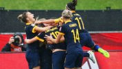 The Matildas celebrate becoming the first Aussie team to win a knock-out match at a World Cup.
