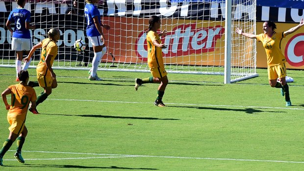 Matildas players celebrate a goal in their 6-1 win over Brazil at the Tournament of Nations.