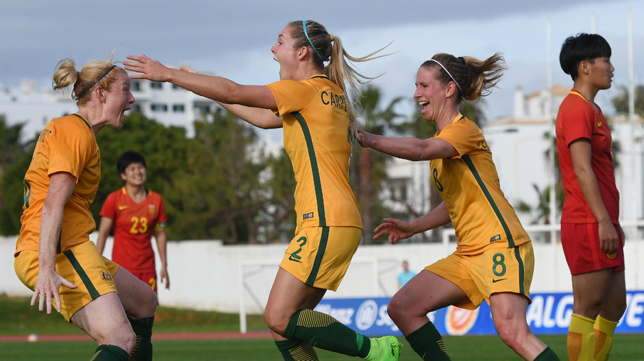 Westfield Matildas players celebrate with Ellie Carpenter after her late winner.