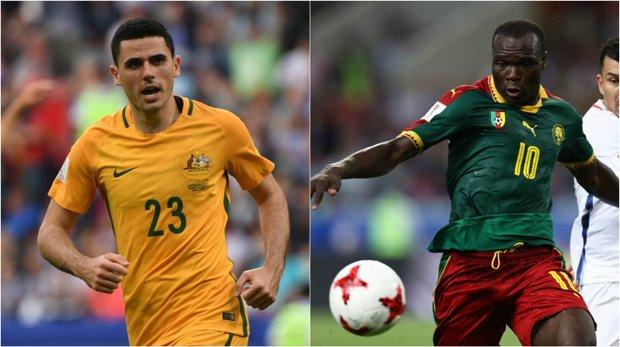Caltex Socceroos playmaker Tom Rogic and Cameroon striker Vincent Aboubakar.