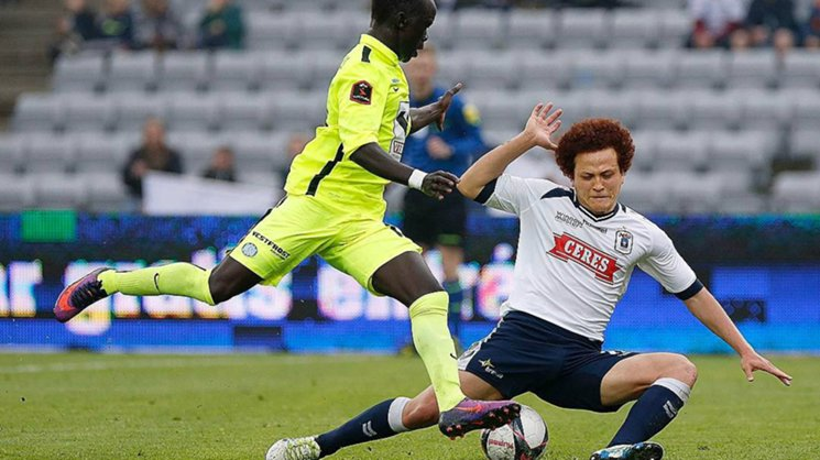 Mustafa Amini fights for the ball with fellow Aussie Awer Mabil. Image credit: Mustafa Amini.