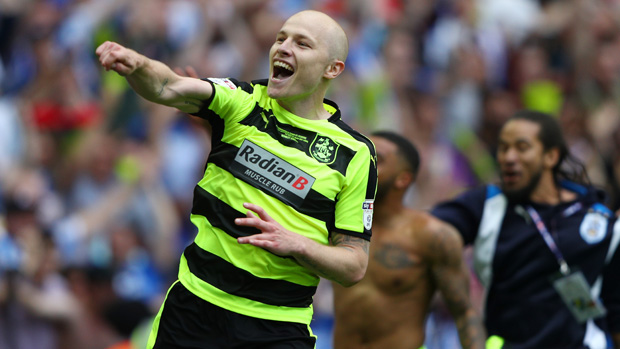 Aaron Mooy has sealed a permanent move to Huddersfield Town.