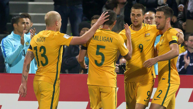 The Caltex Socceroos celebrate Tomi Juric scoring against Iraq in a World Cup Qualifier.