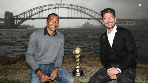 Brazil legend Gilberto Silva and Socceroos great Harry Kewell in Sydney with the Confederations Cup trophy.