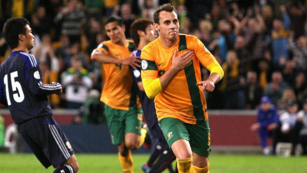 Luke Wilkshire celebrates scoring for the Socceroos against Japan at Brisbane Stadium in 2012.