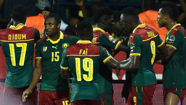 Cameroon players celebrate scoring against Ghana at the African Cup of Nations.