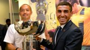 Ali Abbas alongside Shinji Ono with the AFC Asian Cup trophy.