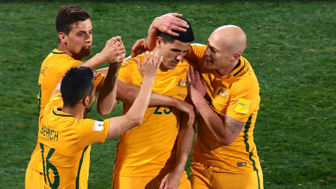 Australian players celebrate Tom Rogic's stunning strike in the Socceroos' 3-2 win over Saudi Arabia.
