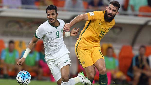 Caltex Socceroos skipper Mile Jedinak battles for possession in the previous qualifier against Saudi Arabia, which ended 2-2.