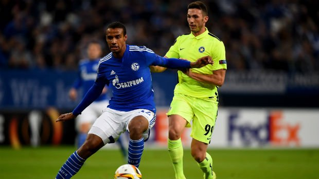 Asteras Tripolis FC striker Apostolos Giannou (right) vies for the ball with Schalke's Joel Matip in the Europa League.