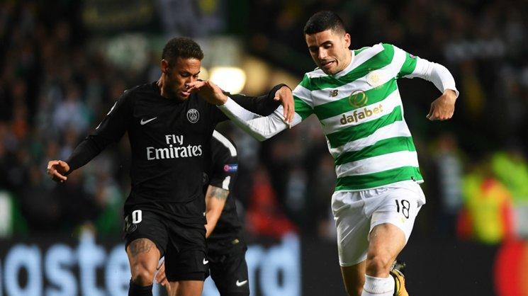 Caltex Socceroo Tom Rogic battles Neymar for possession during Celtic's heavy UCL loss to PSG.
