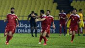 Syria players celebrate a goal against China in Malaysia.