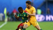 Socceroos star Mat Leckie challenges for the ball with Cameroon's Collins Fai.