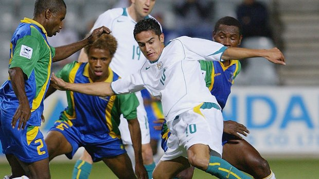 A young Tim Cahill fights for the ball against the Solomon Islands at Hindmarsh Stadium in 2004.