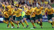 Socceroos players celebrate amid chaotic scenes in Sydney.