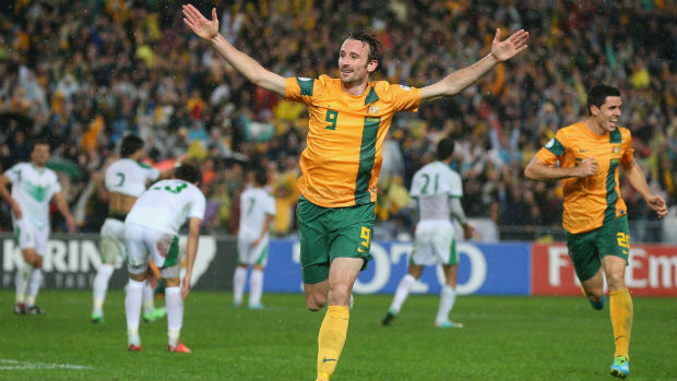 Former Socceroos striker Josh Kennedy celebrates scoring the goal that sealed Australia's place at the 2014 FIFA World Cup.