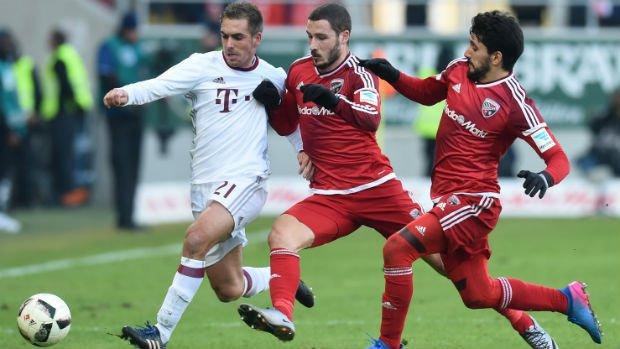 Mathew Leckie tackles Bayern Munich's Philipp Lahm in their Bundesliga clash.