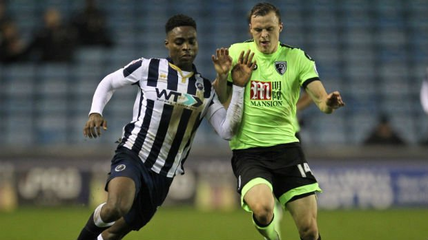 Defender Brad Smith challenges Millwall's Fred Onyedinma for the ball in the third round of the FA Cup.