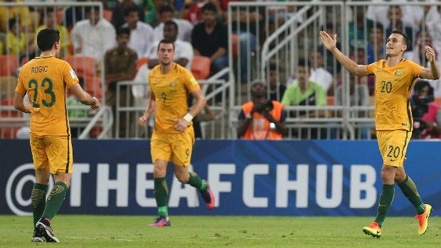 Trent Sainsbury celebrates scoring against Saudi Arabia with Tom Rogic and Tomi Juric.