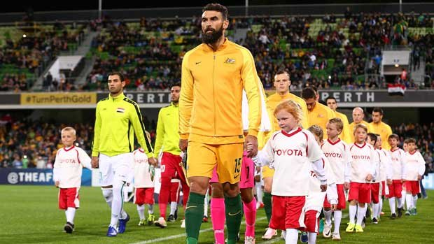 Skipper Mile Jedinak leads out the Caltex Socceroos the last time Australia played Iraq, a 2-0 win in Perth.
