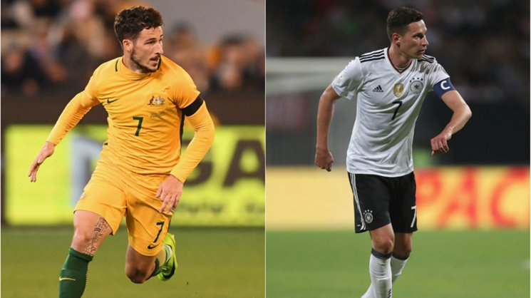Caltex Socceroos flyer Mat Leckie and German captain Julian Draxler.