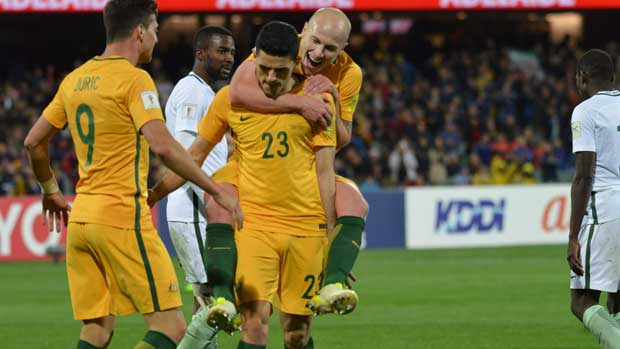 Aaron Mooy celebrates Tom Rogic's goal against Saudi Arabia.