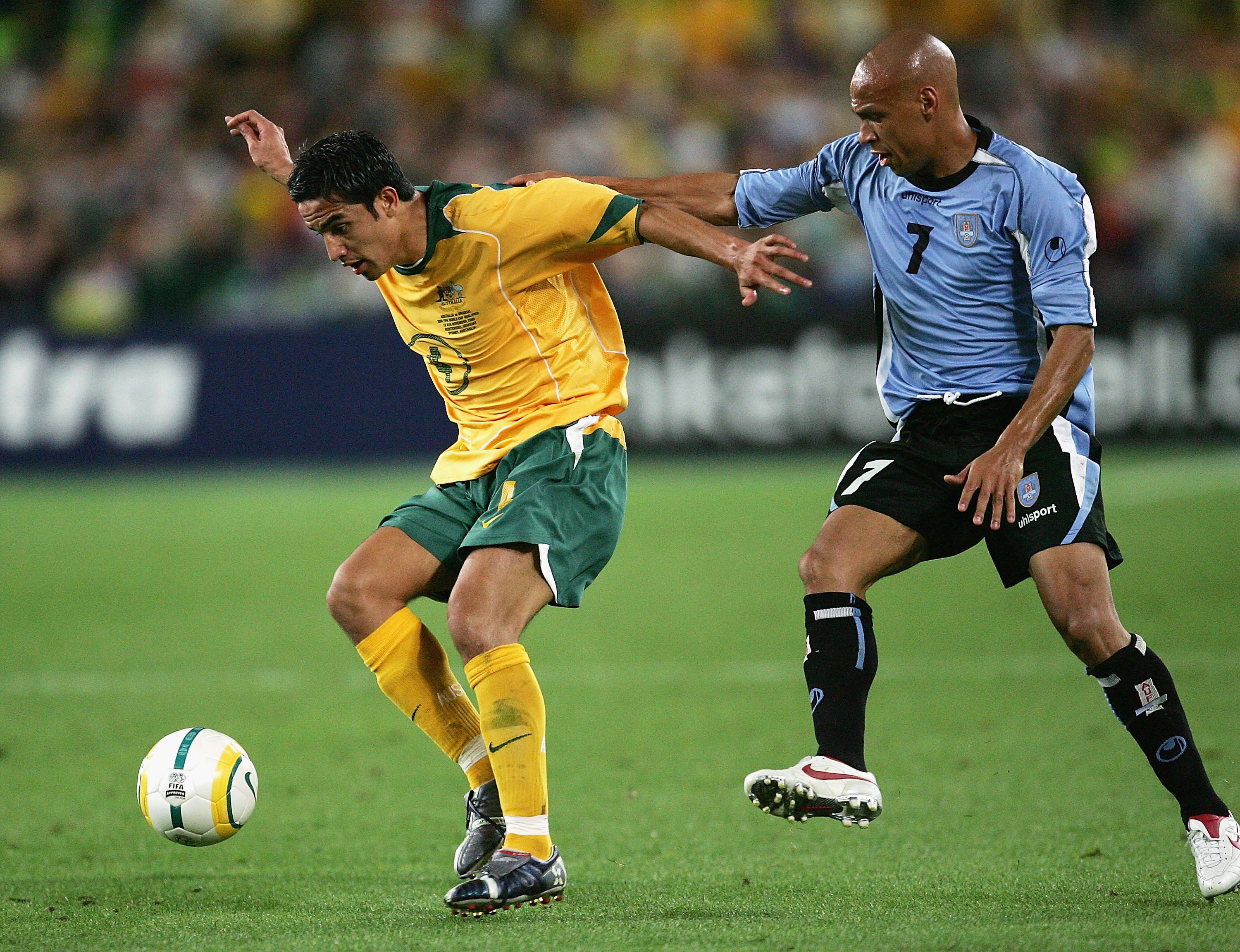 A fresh-faced Tim Cahill started as Australia absorbed a series of Uruguayan attacking raids in the opening 20 minutes.