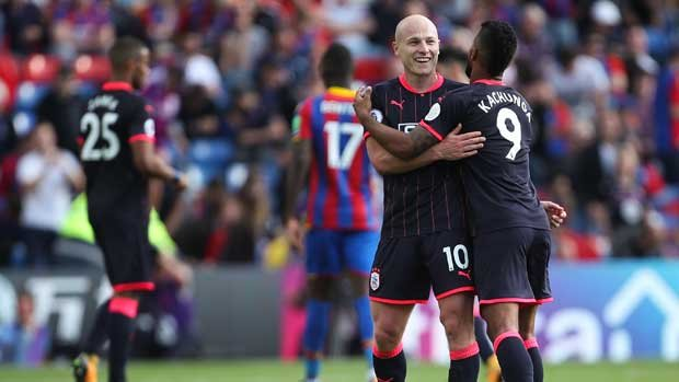 Aaron Mooy celebrates after Huddersfield Town's 3-0 win over Crystal Palace in the EPL opener.