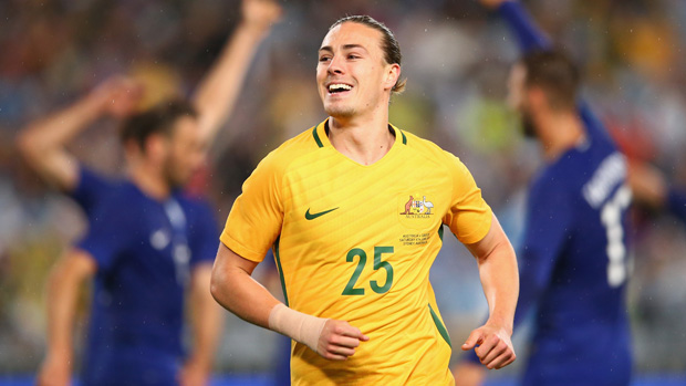 Jackson Irvine celebrates a goal in Australia's friendly win over Greece in 2016.