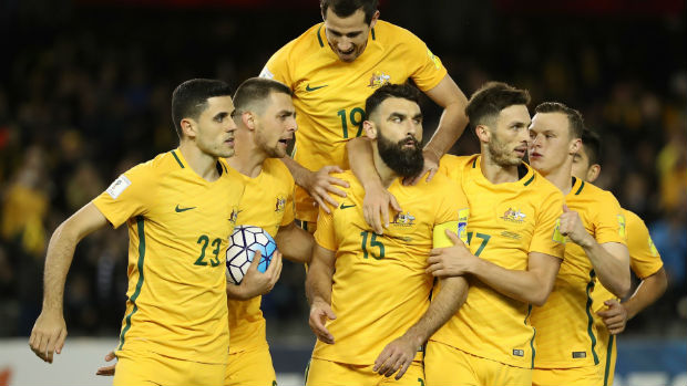The Caltex Socceroos celebrate scoring against Japan in their World Cup Qualifier on home soil.