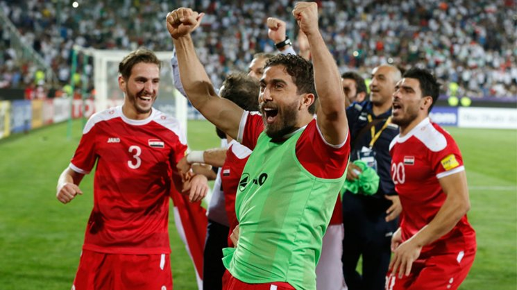 Syria players celebrate their 2-2 draw with Iran, which set up the clash with the Caltex Socceroos.
