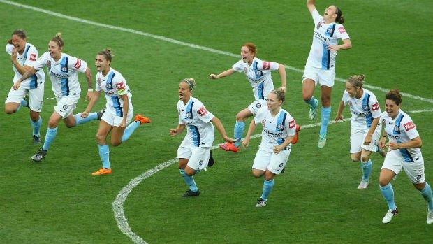 Melbourne City players celebrate Lisa De Vanna's decisive conversion in the penalty shoot-out against Brisbane.