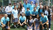 The Futsalroos alongside some students during a school visit in Colombia.