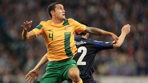 Tim Cahill flies high against Japan in a Socceroos World Cup qualifier.