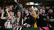 Juventus supporters watch the Serie A Champions train during an open session in Sydney.