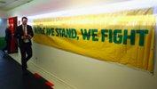 Joeys head coach Tony Vidmar walks down the tunnel with an Australian banner on display