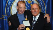 Johnny Warren being honoured with the FIFA Centennial Order of Merit alongside FIFA President Sepp Blatter.