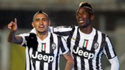 Juventus stars Arturo Vidal and Paul Pogba celebrate during last season's Serie A.